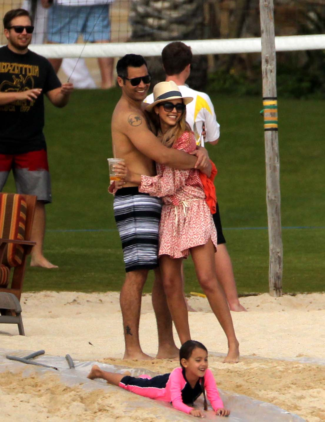 Jessica Alba and Cash Warren hugged while watching their daughter play in Cabo in January.