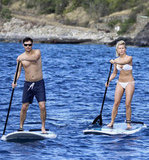 Bikini-clad Julianne Hough and shirtless Ryan Seacrest showed off their paddleboard skills in St. Barts together in December 2012.