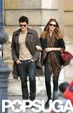Miranda Kerr and Orlando Bloom linked arms strolling around the streets of Paris in September 2009.