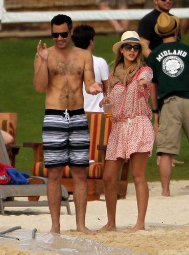 Jessica Alba hung with her husband, Cash, in the perfect, laid-back vacation look — a printed romper that she warmed up with a scarf and finished with a fedora.