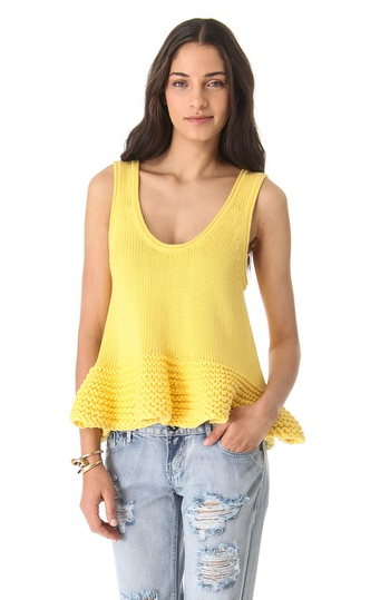 We dig this Bec & Bridge yellow knitted top ($330) because it almost looks homemade! It would look great with jeans during the day and black leather pants at night.