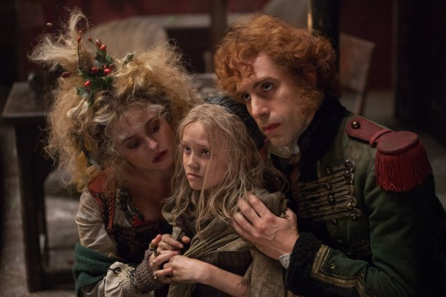 There is some serious drama afoot, but we are totally distracted by the wacky hairstyle on Helena Bonham Carter's character, Madame Thénardier.