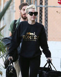 "Miley Cyrus threw on her ""Homies"" sweatshirt."