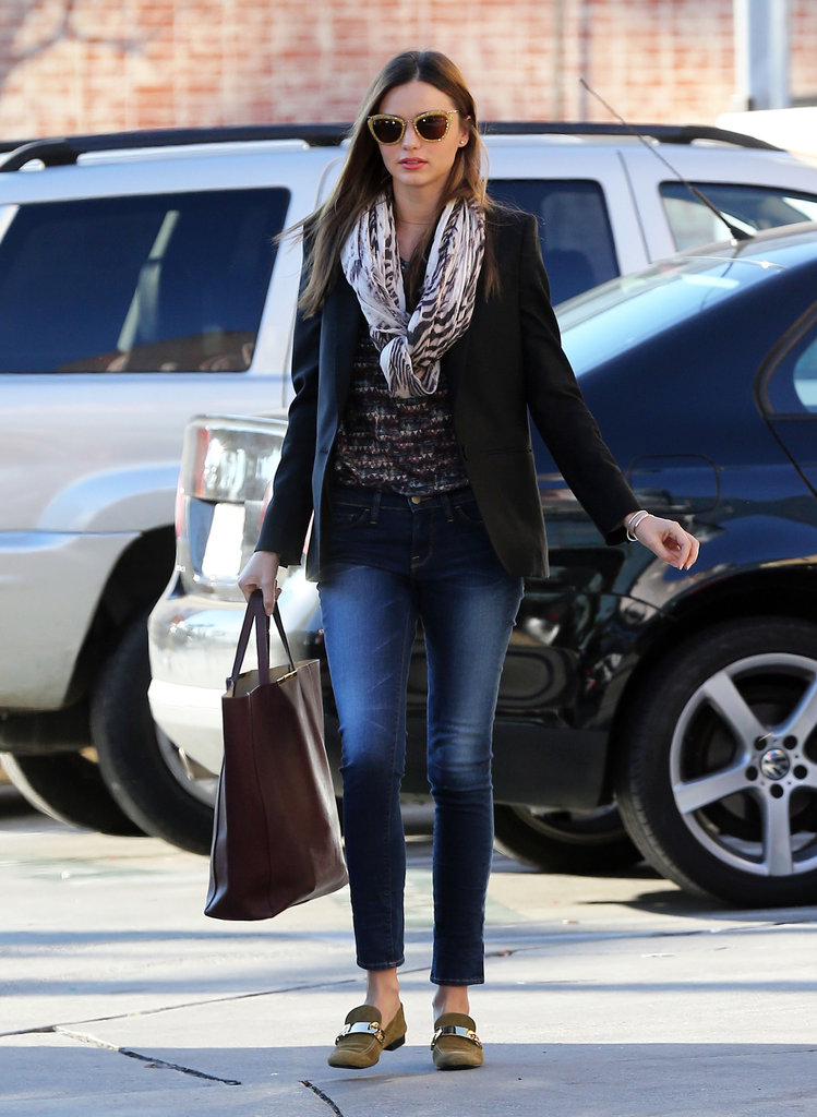 Miranda bundled up on a chilly LA day in a Stella McCartney blazer and tiger-print Mulberry scarf. She added a bit of schoolgirl cool with a pair of suede Céline loafers.