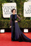 Homeland actress Morena Baccarin channeled the glitz and glam of old Hollywood in her sheer-sleeved gown.