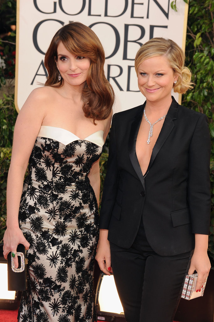 Hosts Tina Fey and Amy Poehler posed together on the Golden Globes red carpet.