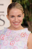 Sienna Miller smiled on the red carpet, striking a few poses in her colorful gown.