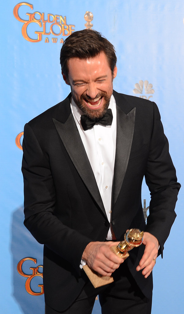 Hugh Jackman held his trophy in the Golden Globes press room.