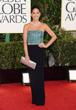 Olivia Munn took to the carpet in a teal and black Giorgio Armani gown.