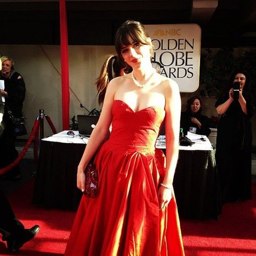Zooey Deschanel styled her red dress with a pearl necklace on the Golden Globes red carpet. Source: Instagram user goldenglobes