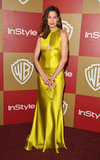Michelle Monaghan put a bright spin on her afterparty ensemble, opting for a vibrantly silky chartreuse number and a red lip.