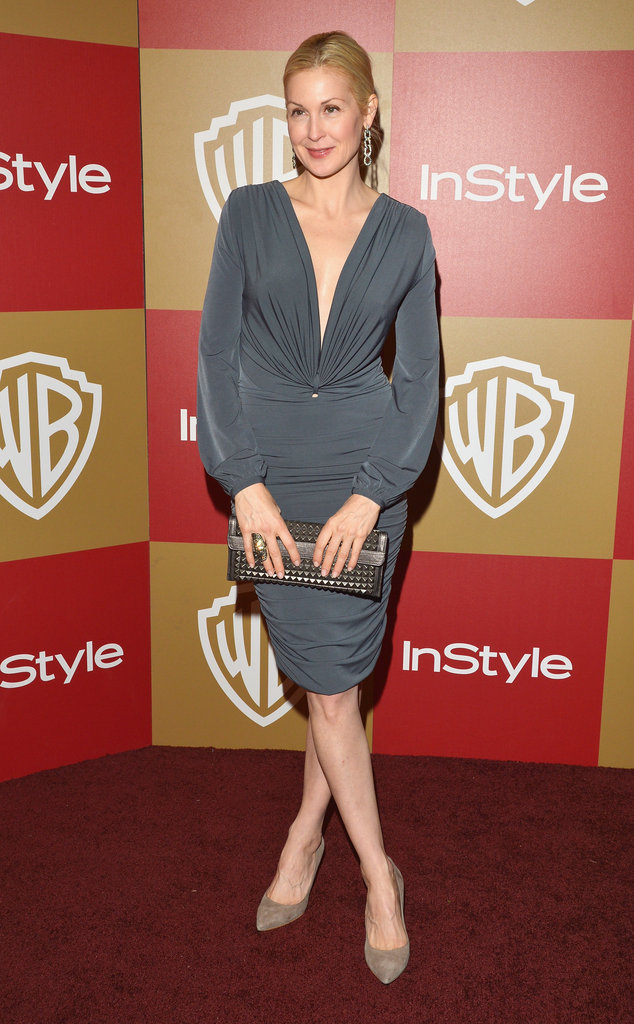 Kelly Rutherford slipped into a slinky grey cocktail dress and paired it with a metallic clutch and nude pumps.