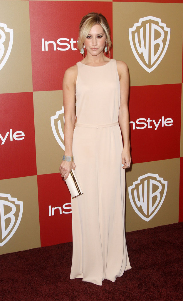 Ashley Tisdale chose a soft blush-toned gown, along with minimalist accessories — like her L.K. Bennett clutch — for her evening out.