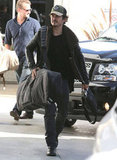 Orlando Bloom headed out of town with his snowboard gear in tow.