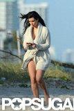 Pregnant Kim Kardashian Shows Her Bikini Bottoms at a Beach Shoot