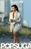 Kim Kardashian covered her baby bump in Miami.