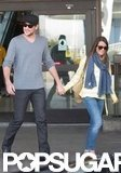 Lea Michele and boyfriend Cory Monteith held hands as they made their way out of LAX.