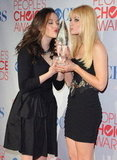Kat Dennings and Beth Behrs posed with their award in 2012.
