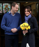 Kate's bright yellow flowers popped against her dark plaid coat and lavender scarf as she left the hospital following her pregnancy announcement.