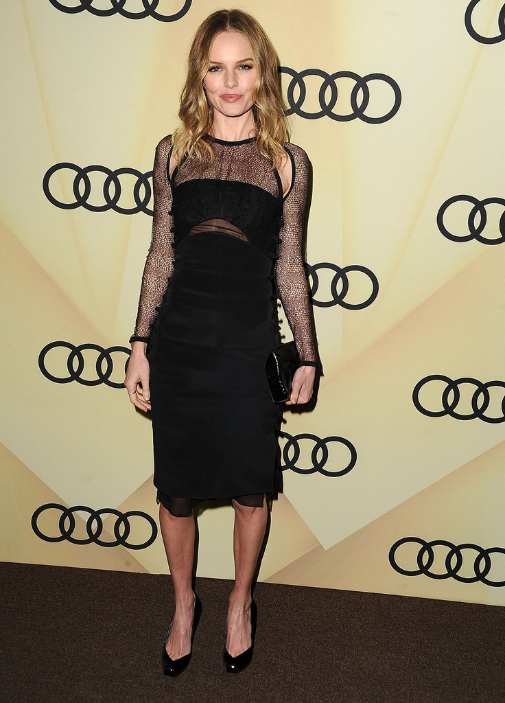 Kate Bosworth was the picture of cool in an Emilio Pucci black dress. What we love most, though, is that Kate never veers into boring LBD territory; instead, the knee-length number features sexier sheer overlays and shoulder cut-outs. To finish off the look, she accessorised with a black python clutch and black pumps.
