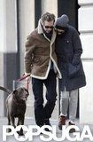 Anne Hathaway and Adam Shulman walked with their dog.
