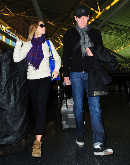 Emily Blunt talked with John Krasinski as they made their way through the airport.