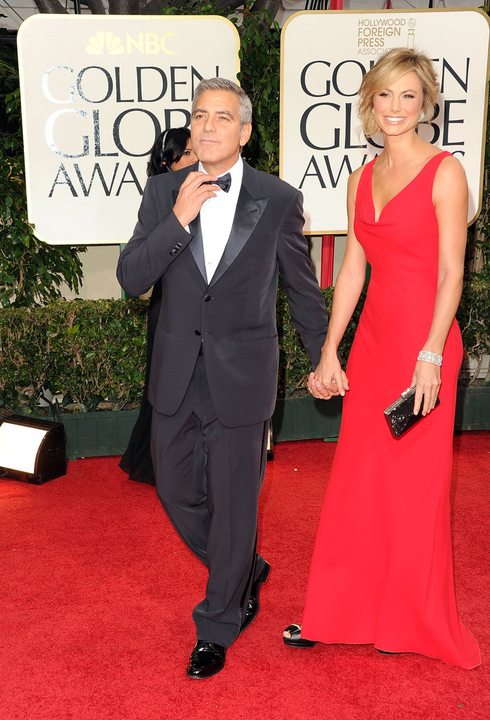 George Clooney fixed his bow tie while escorting Stacy Keibler in 2012.