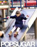 Suri went down a slide.