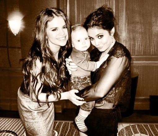 Selena Gomez and Vanessa Hudgens cuddled with a small fan. Source: Twitter user selenagomez