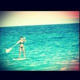 Nicole Richie showed off her paddleboarding skills in a bikini. Source: Instagram user nicolerichie