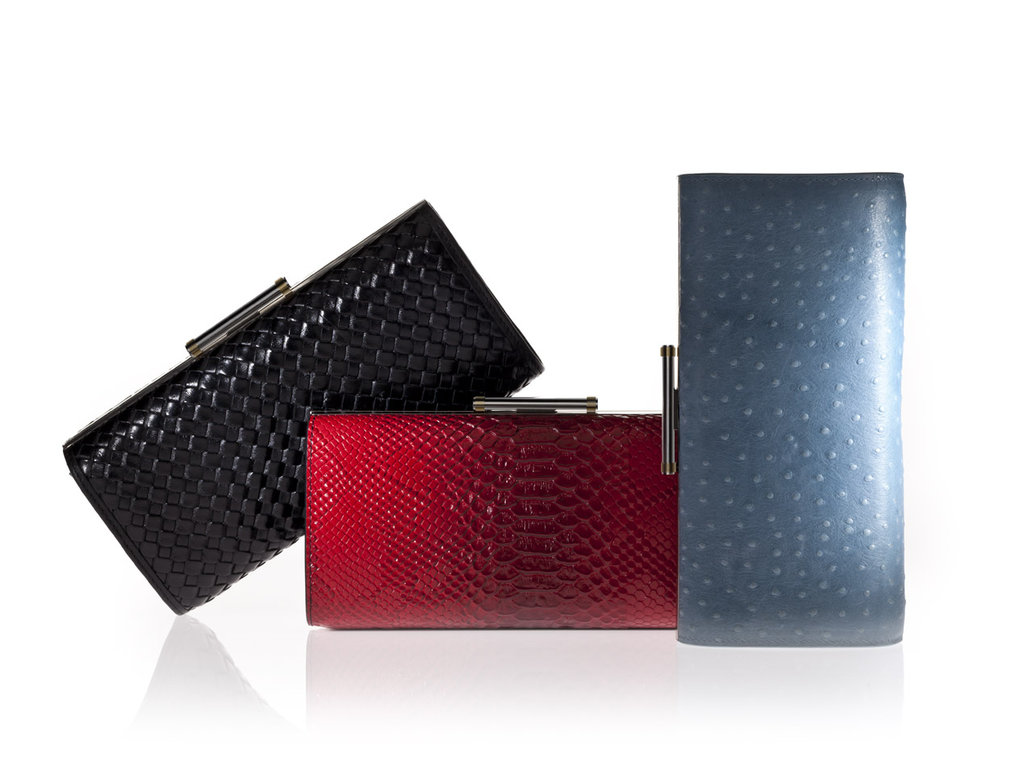 Stellé Audio Clutch in Ostrich Skin Blue, Red Snakeskin, and Black Weave ($299)