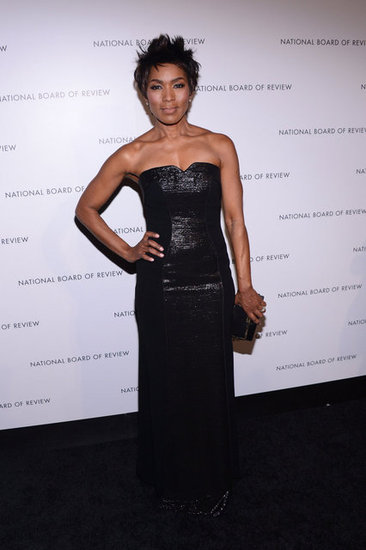 Angela Bassett showed off her curves in a body-conscious black strapless gown with metallic detailing.