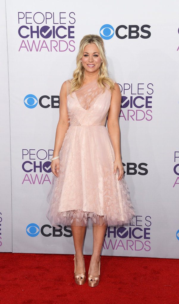 Hostess Kaley Cuoco was all about the femme feel in a petal-pink Christian Siriano dress.