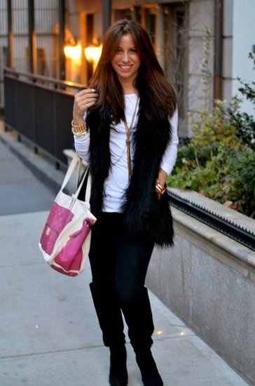 wearing a faux fur vest and leggings