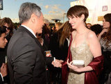 Anne Hathaway chatted with Ang Lee at the Critics' Choice Awards.