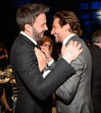 Best director winner Ben Affleck had a bromance moment with best actor in a comedy winner Bradley Cooper backstage.