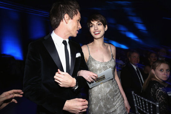 Eddie Redmayne held on to Anne Hathaway.