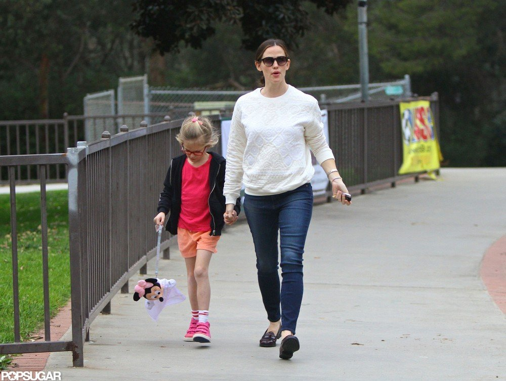 Jennifer Garner wore a white sweater.