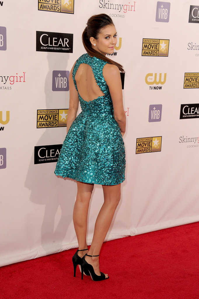Nina Dobrev showed off the back of her Monique Lhuillier dress.
