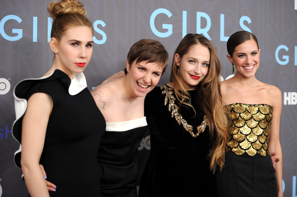 The cast of Girls posed together on the red carpet.