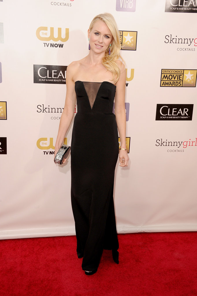Naomi Watts showed some cleavage in a black Emilio Pucci gown.
