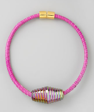 This Eddie Borgo pink choker ($475) would stand out against a silky white button-down and jeans. It would also look amazing with a colorful printed dress.