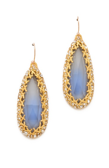 Create a high-contrast look and pair Alexis Bittar's Siyabona earrings ($275) with a little black dress and point-toe pumps.