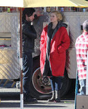 Evan Rachel Wood covered up her baby bump in a jacket on set.