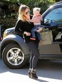 Hilary Duff carried baby Luca Comrie over to a friend's house.
