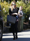Hilary Duff made her way over to a friend's with Luca Comrie.