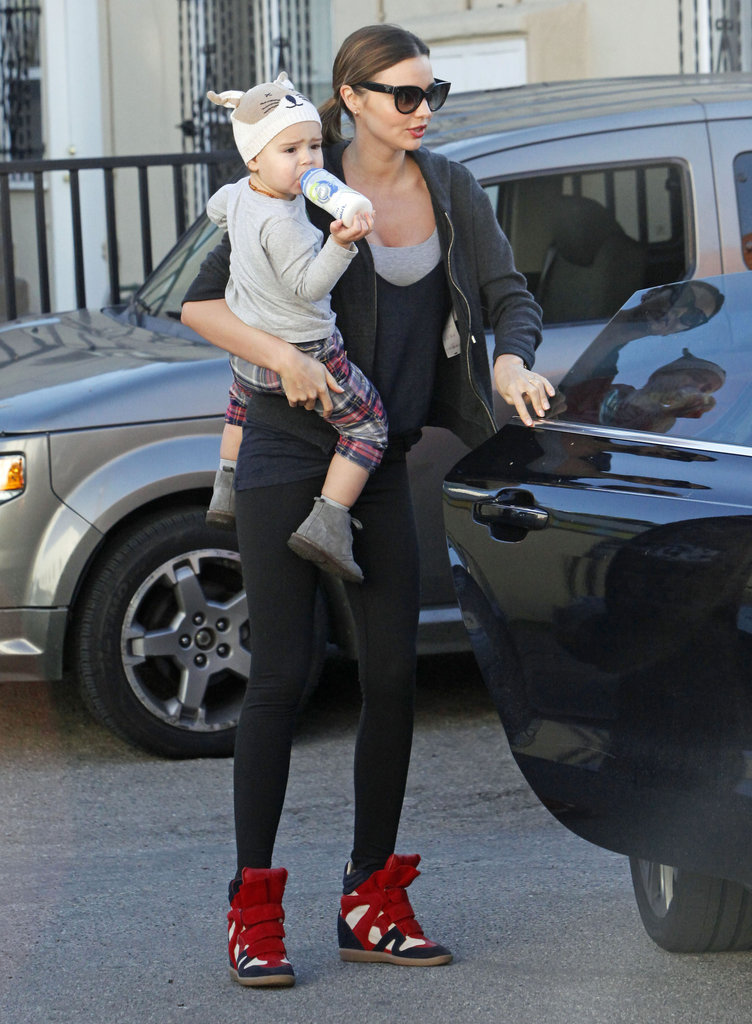 Miranda Kerr gave Flynn Bloom a lift into the gym.