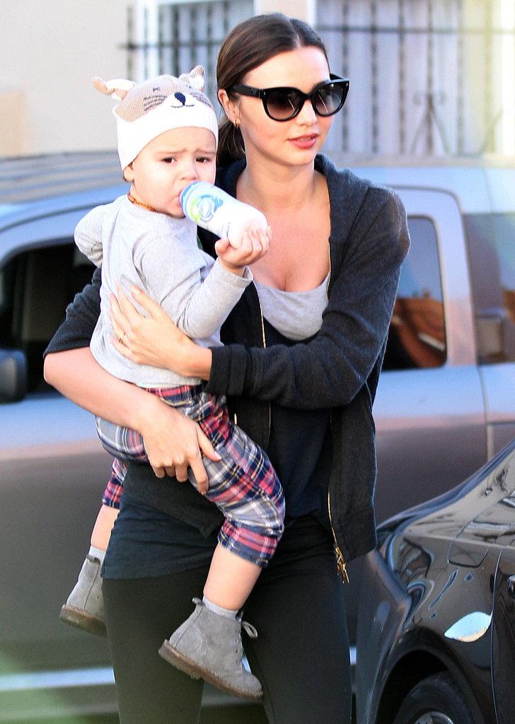 Miranda Kerr donned workout gear as she carried Flynn Bloom.