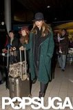Jessica Alba wore a green coat and a hat.