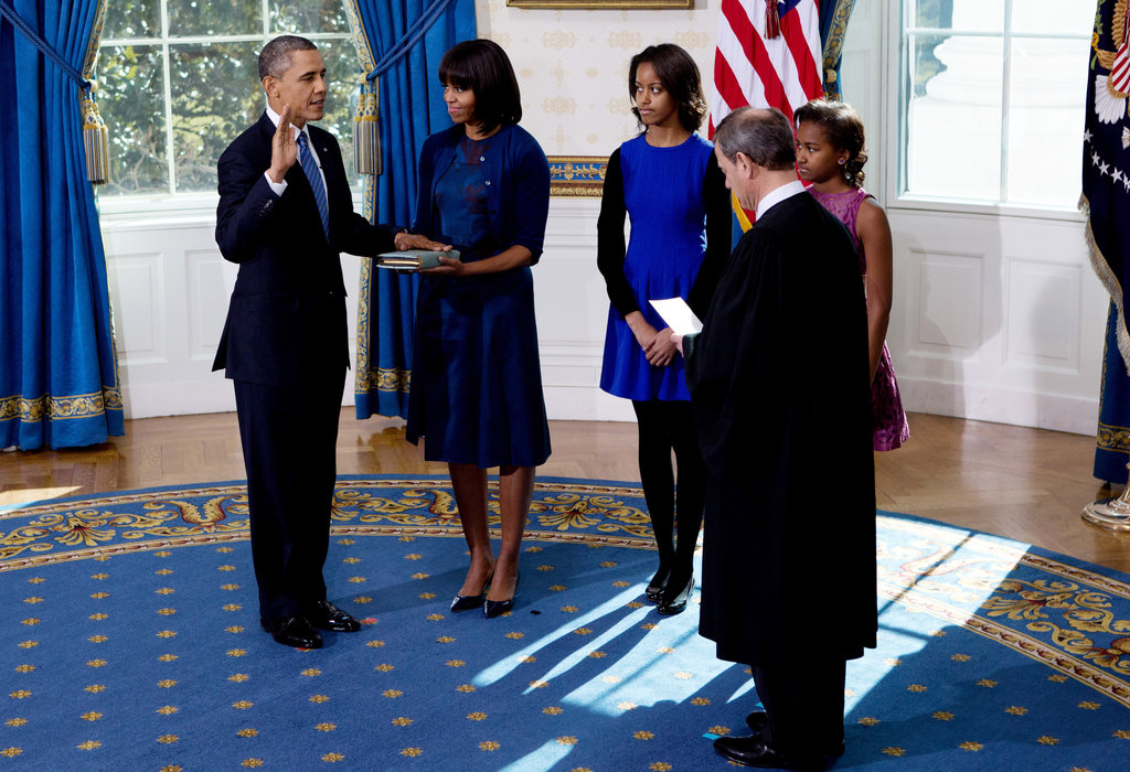 President Obama was sworn in privately with wife Michelle Obama and daughters Sasha and Malia by his side.